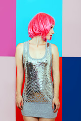 woman girl pink hair silver dress background multicolored graphic red blue portrait beauty tenderness disco deadpen emotions
