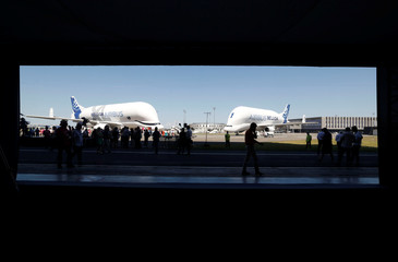 An Airbus Beluga XL transport plane, near an Airbus Beluga ST, is seen on the tarmac after its first flight event in Colomiers near Toulouse