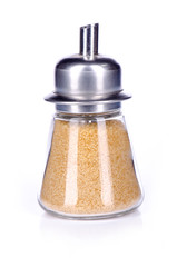 sugar shaker with brown sugar on white background