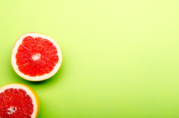 red grapefruits on a green background