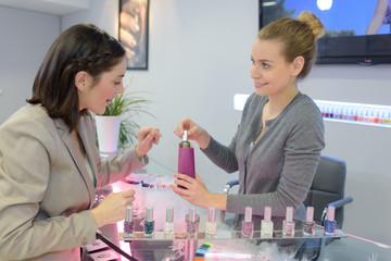 cheerful women in cosmetics store