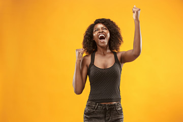 Winning success woman happy ecstatic celebrating being a winner. Dynamic energetic image of female afro model