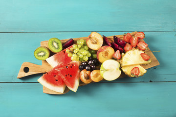 Summer fruits on wooden background