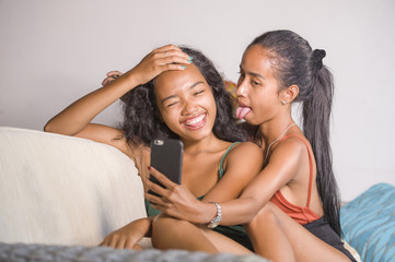 young happy and beautiful Asian sisters or girlfriends couple sm