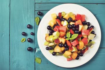 Mixed summer fruits salad top view