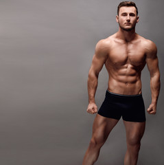 Athletic Man Fitness Model Torso showing big muscles.