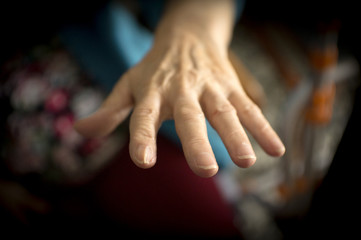 Hands of elderly woman with alzheimer