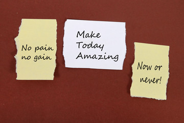 """""""No pain no gain.""""  """"Make Today Amazing."""" """"Now or never!""""  Note pin on the bulletin board."""