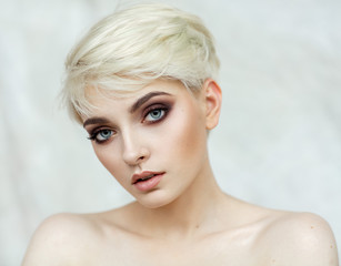 Beauty portrait of blond model in fashionable haircut