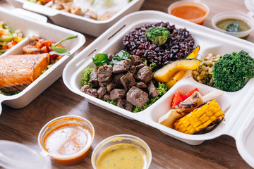 Clean food meal box: Diced grilled beef served with rice berry, broccoli, bean sprout, corn, mushroom and tomato.