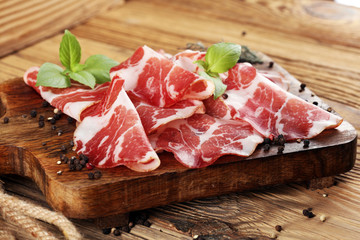 Italian sliced cured coppa with spices. Raw ham. Crudo or jamon