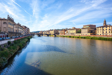 Colorful old buildings line the Arno River in Florence, Italy