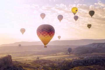 Flight in a hot air balloon. Beautiful view from the height of the flight in a hot air balloon. Bright balloons