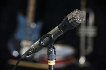 Old microphone. Mic or mike was professionaly used in sixties of the twentieth century in radio stations, concert halls, audio engineering, sound recording.