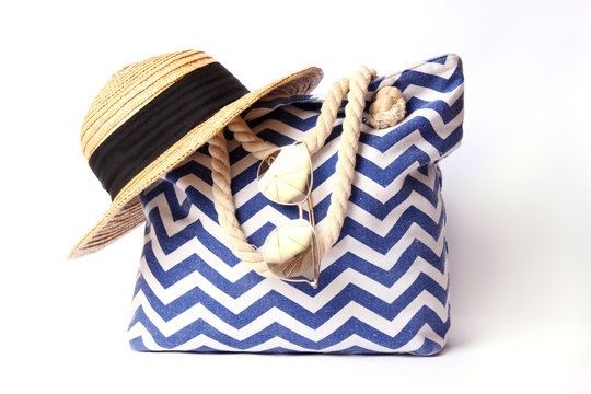 beach bag and hat isolated on white