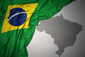 Photo sur Toile Brésil waving colorful national flag and map of brazil.