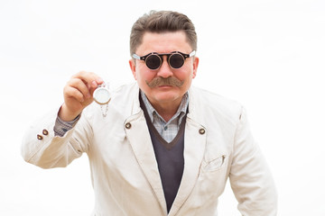 Time! A sly man in glasses shows his pocket watch.
