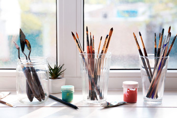 Set of painting tools on window sill
