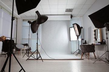 Interior of modern photo studio with professional equipment Wall mural
