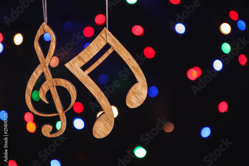 273ba65e47db0 Wooden treble clef and note against defocused lights. Christmas music  concept