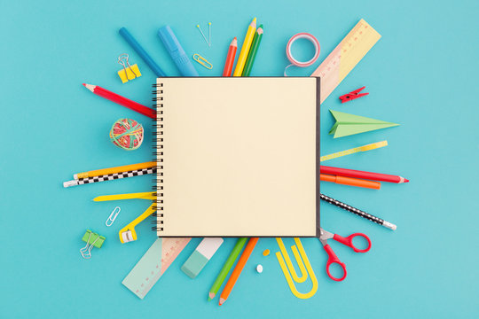 School notebook and stationery. Back to school, creative concept, flat lay..