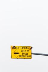 Right hand bus lane warning road sign.
