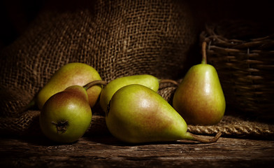 Thigh pears on wooden table.