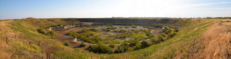 A huge quarry with an abandoned building. The foundation of a large structure.