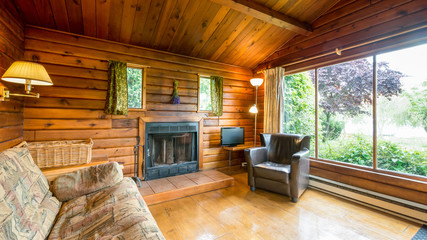 Cozy interior of a living room in a rustic log cabin.