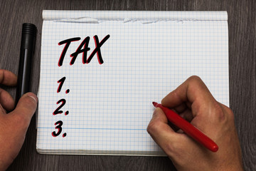 Handwriting text writing Tax. Concept meaning Compulsory payment of taxes by people to government increase revenue Graph paper thoughts ideas important marker pens practical book jobs.