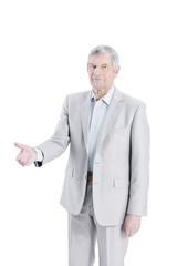 confident senior businessman holding out hand for a handshake