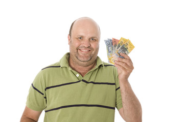 An average midddle aged man showing Australian currency