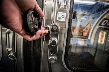 Subway door handle being lifted to open door