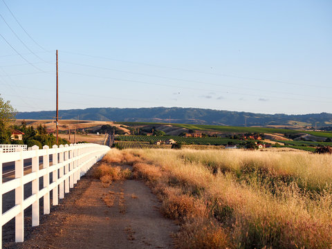 White picket fence at sunset on Greenville Road at Tesla Road, Livermore Wine Country, California