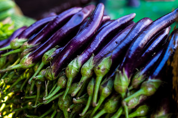 Stack of freshly picked organic eggplants. Selective focus.
