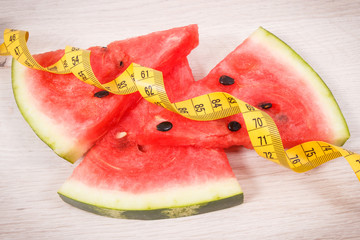 Watermelon and centimeter, concept of healthy nutrition, slimming and fruit containing minerals