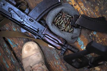 soldier boots and handgun close up. war.