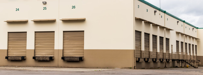 Tan and brown warehouse industrial building and garage doors