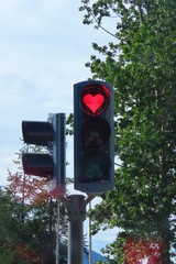 Red heart-shaped traffic light as a sign of hope and love in Akureyri, Iceland