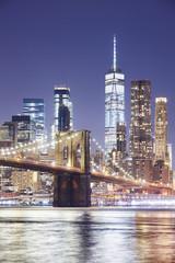 Brooklyn Bridge and Manhattan skyline at night, New York City, USA.