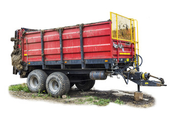 Agricultural machinery on a dairy farm.Trailer-distributor of fertilizers from cow manure and straw after working in the field. Isolated general view.