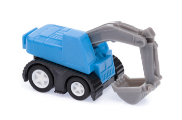 The toy tractor isolated on a white background.