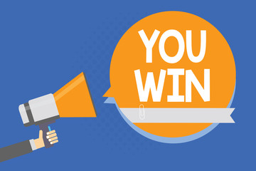 Text sign showing You Win. Conceptual photo be first in school race or competition Got gold medal Rating Man holding megaphone loudspeaker orange speech bubble blue background.