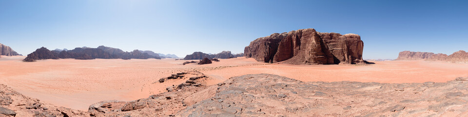 Panorama of a desert landscape in Wadi Rum, Jordan, famous for movies like The Martian and Lawrence of Arabia.