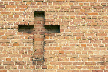 cross on a brick wall