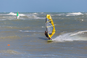 Sea Waves and Wind Surfing in the Summer in Windy Day