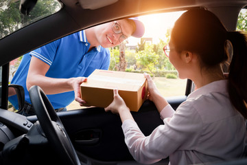 Delivery man service delivering package box to happy woman, delivery concept