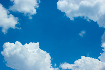 Blue sky with white clouds. Daytime sky. The sky background..