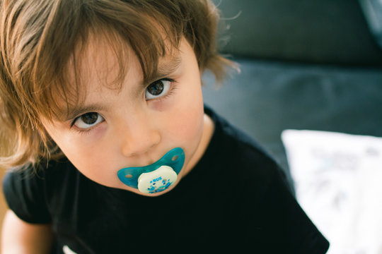 Little with a pacifier