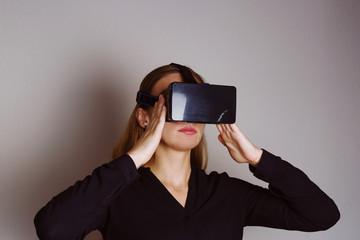Beautiful blonde woman is wearing glasses of virtual reality